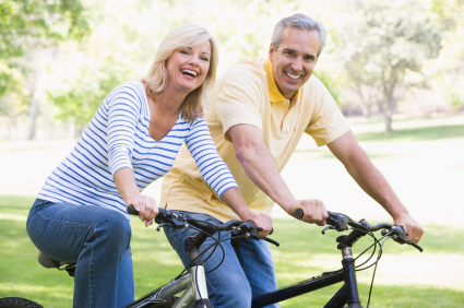 Couple on bikes outdoors