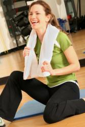 Healthy woman finishing exercise